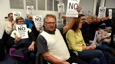 Opponents make their views known earlier this month at the council meeting to accept the new Suffolk