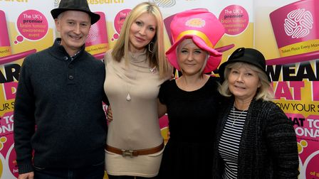 Ms Edgar and her parents Andy Relf and Barbara Relf join Caprice at the Wear a Hat Day launch for B