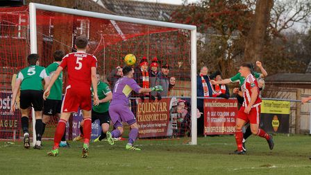 Liam Hillyard's (red right) close range header makes it 1-1 for the Seasiders. Photo: STAN BASTON