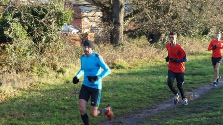 Some of the leading runners enjoying the bright weather but muddy conditions underfoot at Saturday's