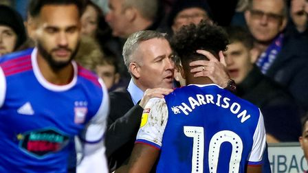 Town manager Paul Lambert has a word in the ear of Ellis Harrison, after bringing him off the pitch