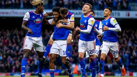Ellis Harrison celebrates with his team-mates after giving the Blues the lead. Picture: STEVE WAL