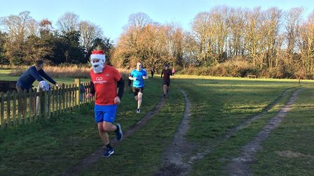 One of the many Santas running in last Saturday's Catton parkrun, held in muddy conditions. Picture: