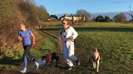 Runners with their dogs tackle the wet and muddy route of the Catton parkrun last weekend. Picture: