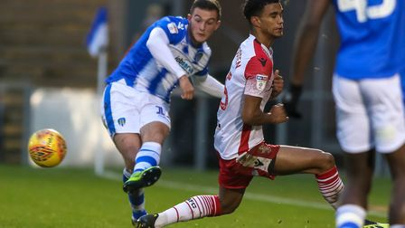 Brennan Dickenson fires the ball forwards during yesterday's 2-1 home defeat to Stevenage. Picture: