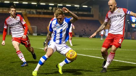 Sammie Szmodics on the ball with Steve Seddon and Scott Cuthbert closing in during the Boxing Day 2-