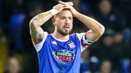 Luke Chambers with his hands on his head after Town had conceded the third goal against Millwall.