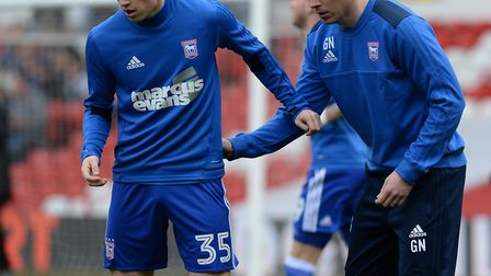 Gerard Nash directing Ipswich players at The City Ground during the warm-up against Nottingham Fores