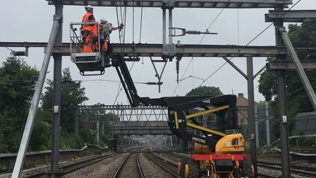 Engineers are replacing overhead lines between Shenfield and Stratford. Picture: NETWORK RAIL