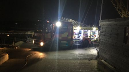 Firefighters at the scene of the houseboat fire in Woodbridge. Picture: JAKE FOXFORD