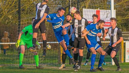 Woodbridge's Arron Churchyard putting the ball in his own net to give Brantham the lead Photo: PAUL