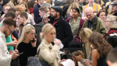 Passengers at Gatwick airport, on December 21, waiting for their flights following the delays and c