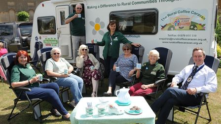 The team from Rural Coffee Caravan with high sheriff George Vestey Picture: CONTRIBUTED