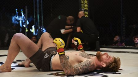 My Fighter of the Year James Webb hits the floor after stopping Jason Radcliffe at Cage Warriors 99