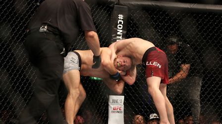 Suffolk's Arnold Allen locks in the ninja choke on Mads Burnell at UFC Liverpool in May - runner-up