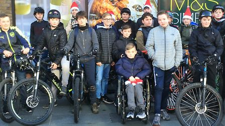 Teenagers gathered with Toby to take part in the cycle safety awareness event Picture: ESSEX POLICE