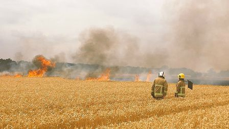 Firefighters tackle a large field blaze in Hadleigh Picture: MARK ELEY/SUFFOLK FIRE AND RESCUE SERVI