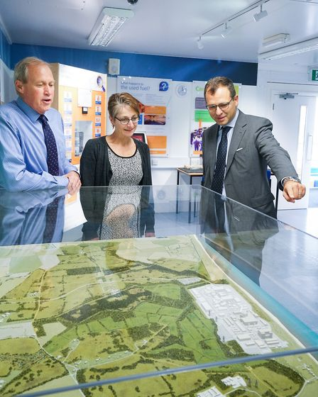 EDF Energy CEO Simone Rossi shows representatives of Leiston Town Council a model of the proposed Si