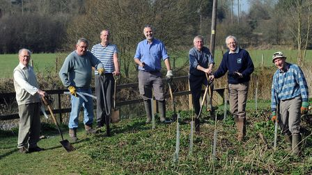 The Long Melford Open Spaces group, pictured planting trees in Melford Country Park, are bidding for
