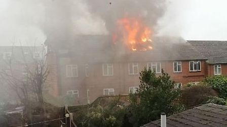 The house could be seen ablaze from neighbouring properties. Picture: AJ ELIZABETH