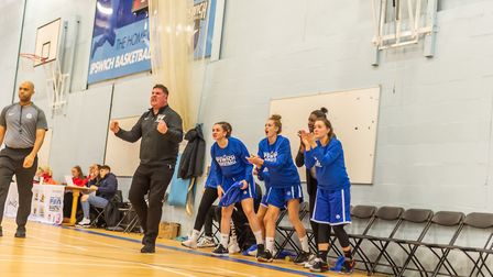 Ipswich head coach Nick Drane and the bench celebrate a key play in the win over Solent. Picture: PA