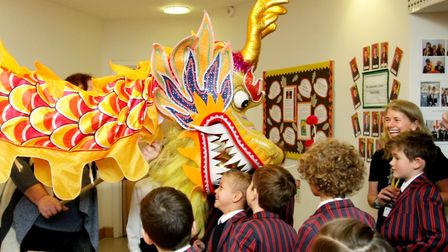 The paper dragon with prep school pupils at St Joseph's College in Ipswich last year during the scho