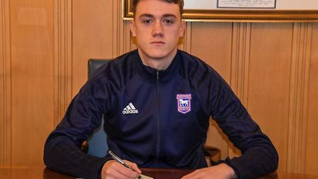 Lankester, pictured signing his extended contract. PICTURE: ITFC