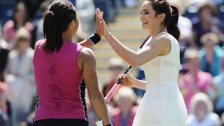 Laura Wright celebrates a point with Heather Watson of Great Britain during their exhibition match o