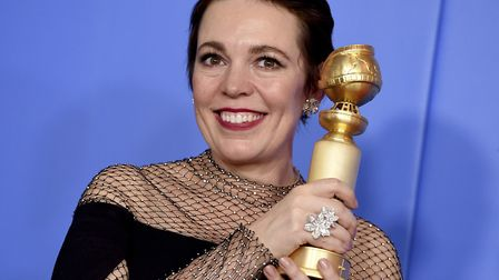 Olivia Colman poses in the press room with the award for best performance by an actress in a motion