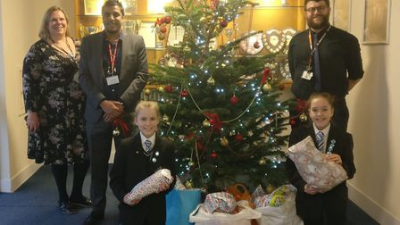 Cassandra Barbosa and Amelia Thomas, from Castle Manor Academy in Haverhill, handed out toys, bears,