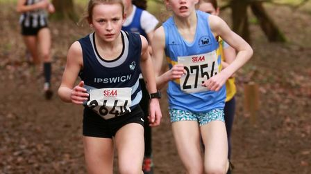 Ruby Vinton (left) who retained her under-13 title at the Suffolk Cross Country Championships.