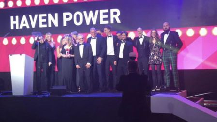 Haven Power team led by Paul Sheffield collects an award on stage with Rob and Jo Brooks from Brickm