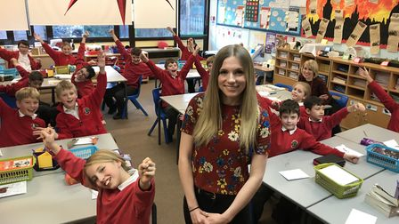 Bethany Havers with her class at All Saints CofE Primary School in Laxfield who have made the best p