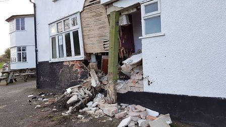 Part of the 15th century pub has been left in pieces after an early morning crash Picture: RACHEL ED