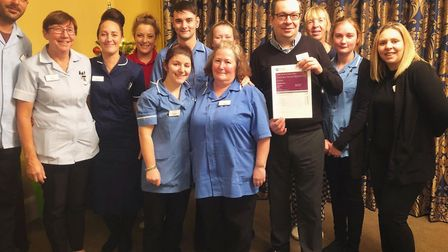 Staff at Fornham House care home in Fornham St Martin celebrate their CQC rating Picture: FORNHAM HO