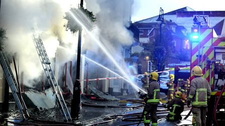 Firefighters tackle the serious fire at the Cycle King shop on Angel Hill in Bury St Edmunds in Sept