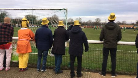 The distinctive Gold hats worn by Stowmarket Town fans at Langford Road last Sunday. Picture: CARL M