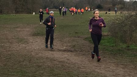 Runners stretched out along the 5K cross country course at the Foots Cray Meadows parkrun on New Yea