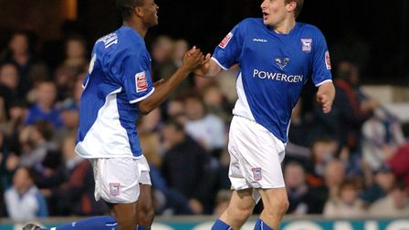 Darren Bent celebrates one of his two goals with Ian Westlake in Town's 2-1 win over Rotherham at ho