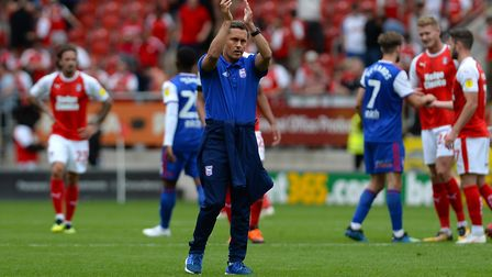 Paul Hurst applauds the travelling fans at Rotherham, after his first defeat as Ipswich Town manager