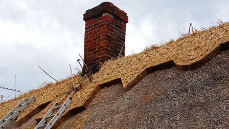 New ridge on old Thatch at Flempton Picture: PETER CUTTS