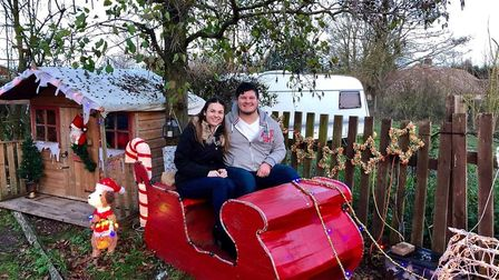 Lauren Johnson and Aaron Clarke in the sleigh at David and Louise Clarke's garden in Ixworth. Pictur