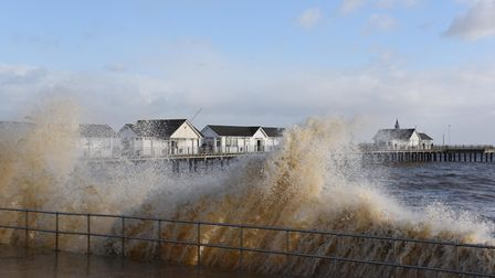 The waves made their way down the prom in Southwold Picture: SARAH LUCY BROWN
