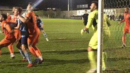 Leiston are on the defensive at St Neots, with keeper Marcus Garnham a picture of concentration. Pic