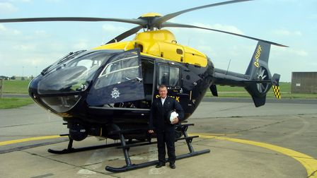 Paul Booker stood with the police helicopter Picture: SUFFOLK CONSTABULARY