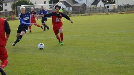 Byron Tejano, right, set up Henley's first goal in their 4-0 win over Capel Plough. Picture: HENLEY