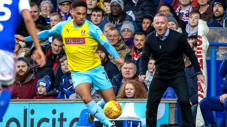 Zak Vyner on the ball for Rotherham as Town manager Paul Lambert looks on. Picture: STEVE WALLER