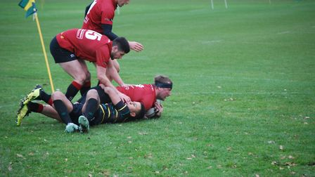 Brock Price crosses for one of his three tries in Colchester's big win. Picture: MAGGIE WHITEMAN