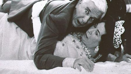 Actor Leslie Nielsen, with actress Jeannette Charles, portraying the Queen of England, in a scene f