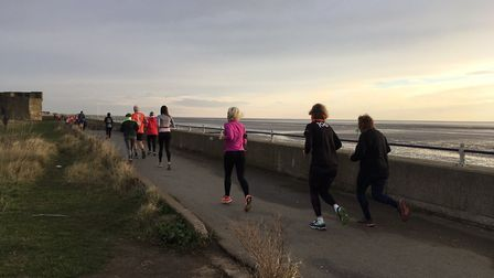 Runners progress along the sea-wall during last Saturday's Southend parkrun. Picture: CARL MARSTON